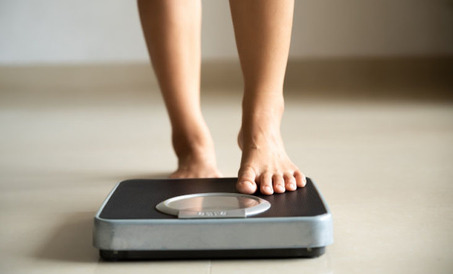 woman measuring the weight